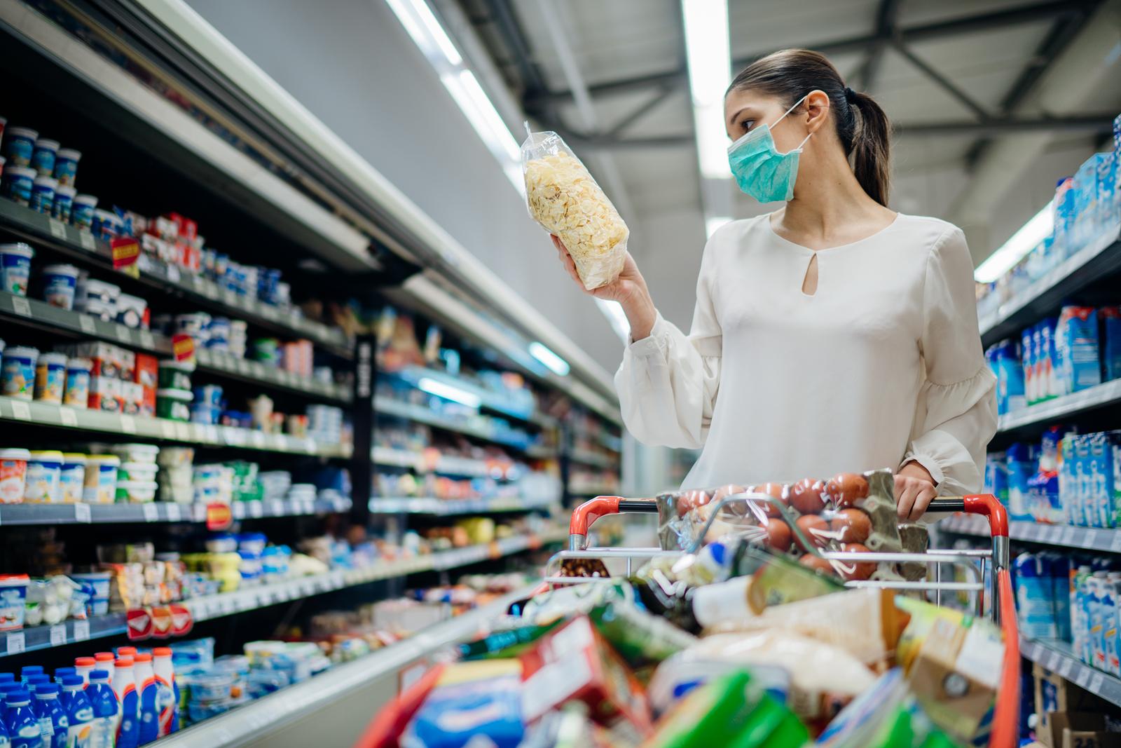 bigstock-Woman-With-Hygienic-Mask-Shopp-357298901